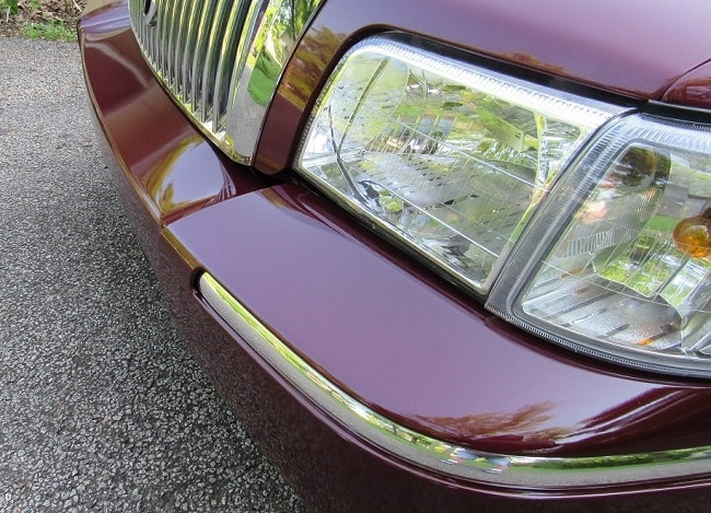 Review of 06 Mercury Grand Marquis in Dark Toreador Red Clearcoat Metallic after installing an MBI painted to match bumper from Amazon.