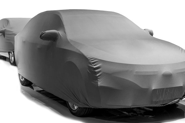 Custom-fit indoor car cover in satin stretch.