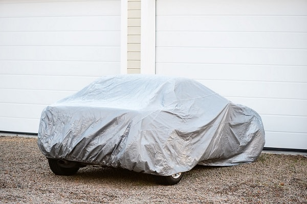 Universal fit car cover for outdoor use.