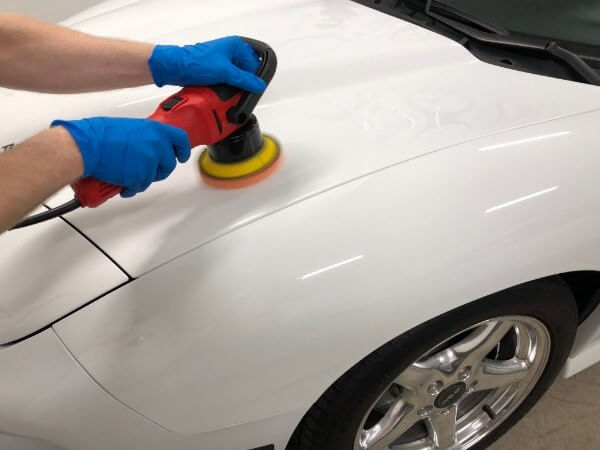 polishing white trans am hood with griots garage polisher