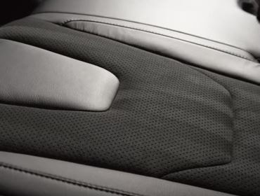 Striped design on alcantara seat in a car interior.