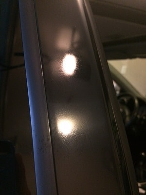 Trim between windows that has been restored by polishing and sealing with a ceramic coating.