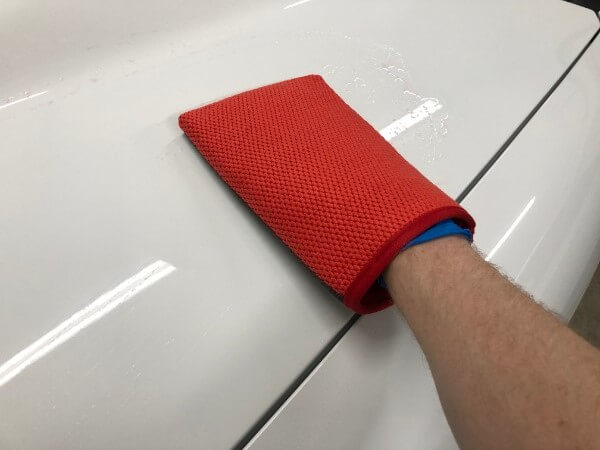 wiping trans am hood with Adam's Polishes Clay Mitt